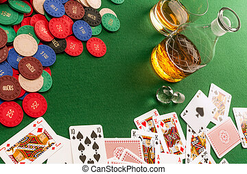 Gambling table with cards and poker chips