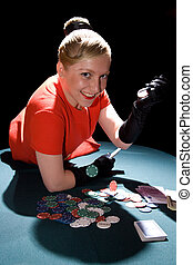 Gambling young woman