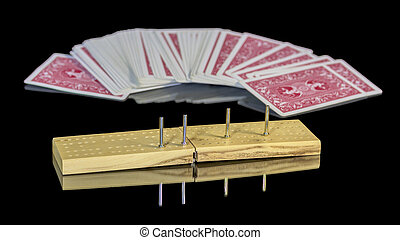 game board of cribbage with deck of cards