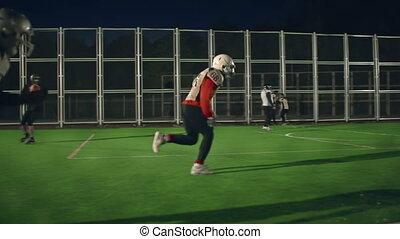 Game Dynamics - Tracking shot of American football play at...