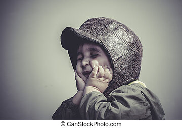 game, fun and funny child dressed in aviator hat and goggles