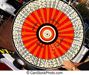 Game of Chance - A game of chance spinning wheel outdoors at...