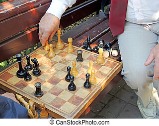 Game of chess on the bench