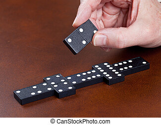 Game of dominoes on leather table - Macro image of dominos ...