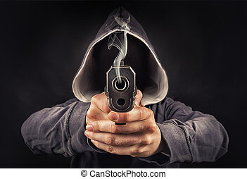 faceless man with a pistol in his hands