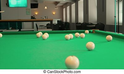 Game party in billiards, young boys and girls play against each other