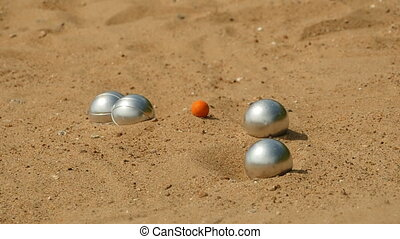 game petanque steel balls game close to  slow motion