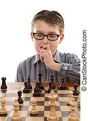 Game Plan - A young chess player contemplates a game plan or...