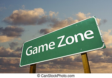 Game Zone Green Road Sign In Front of Dramatic Clouds and Sky.