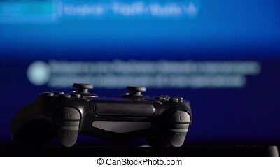 Gamepad and game console. Playing videogames