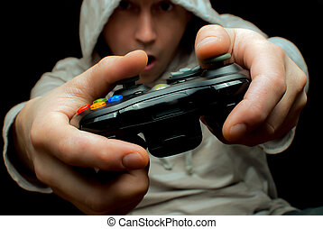 Gamer and controller - man playing with a video game console...