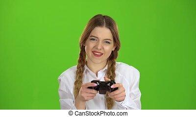 Gamer girl is holding a joystick. Green screen - Gamer girl...