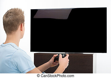 gamer, hos, joystick., bagside udsigt, i, unge, gamer, boldspil spille video