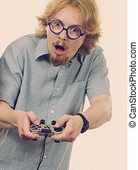 Gamer man holding gaming pad