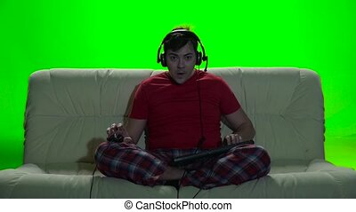 Gamer man many hours spent playing games on the computer -...