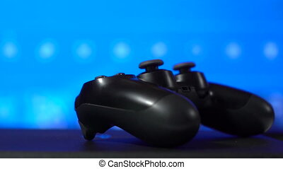 Gamer playing game on video gaming console with wireless...