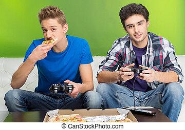 gamers, hos, joystick., to, unge, gamers, boldspil spille video, mens, sidde divanen