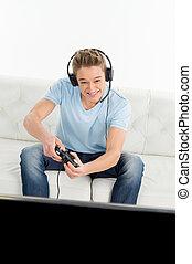 gamers, hos, joystick., unge, gamers, boldspil spille video, mens, sidde divanen