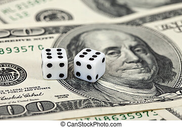 Gaming dice and money