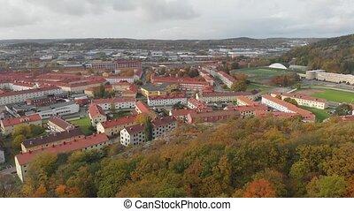 Gamlestaden, Urban District in Gothenburg, Autumn Foliage Reveal, Aerial Rising. High quality 4k footage