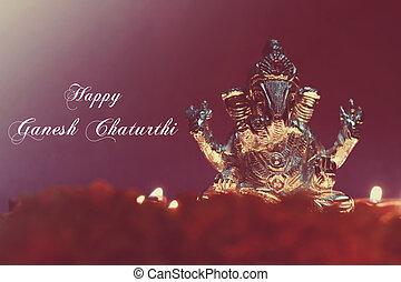 Ganesh idol shining due to oil lamp, festival season, retro effect