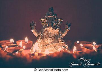 Ganesh idol surrounding with oil lamp, festival season, retro effect