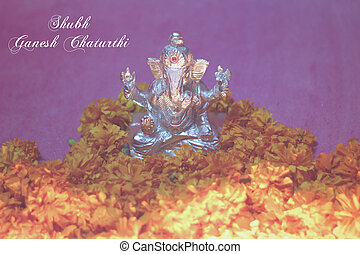 Ganesh idol with sunflower and oil lamp