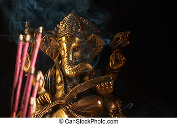 Ganesha and incense sticks - Hindu God Ganesha and smoking...