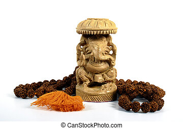 Ganesha and Prayer Beads - A wooden statute of Ganesha...