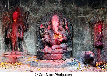 Ganesha - red painted Lord Ganesha in Kathmandu during...