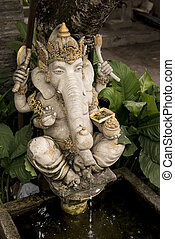 Ganesha statue in front of a house. - Bali, Indonesia - July...