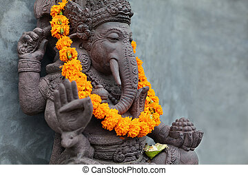 Ganesha with balinese Barong masks, flowers necklace and ...