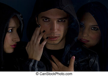 Gang members in the darkness - Portrait of young gang...