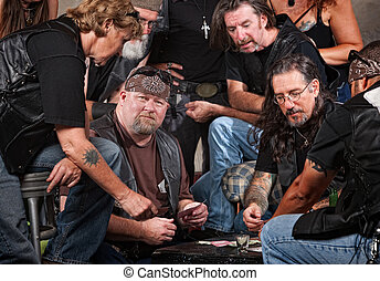 Gang Members Playing Cards - Serious gang members playing...