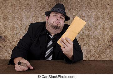 Gangster holding brown envelope