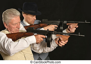 Gangster men with weapon
