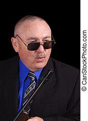 gangster, oder, regierung, agent, fbi, agent, mit, a, maschinengewehr, aus, a, schwarzer hintergrund