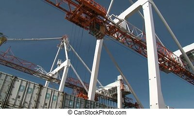 Gantry crane unloading containers - Containers being...