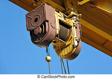 Gantry crane windlass - Full gantry crane windlass over blue...