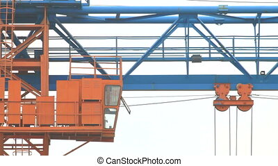 Gantry crane working on the construction site or warehouse