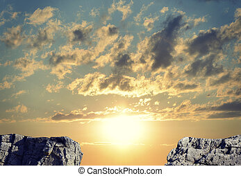 Gap in rocky pathway or chasm between two rocks. Sunrise sky...
