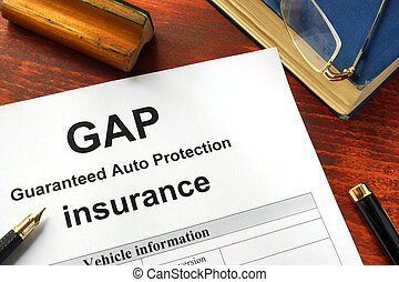 GAP insurance form on a table with a book.