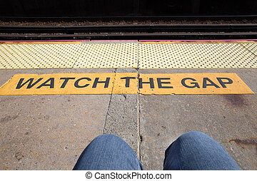 Gap - Railroad warning watch the gap with legs of commuter...