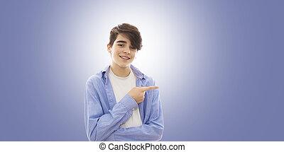 garçon, adolescent, sien, doigt indique