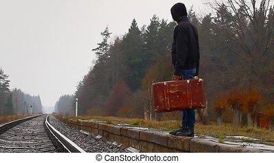 garçon, adolescent, valise