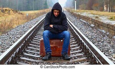 garçon, adolescent, valise, nerveux