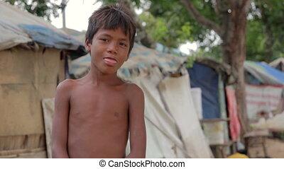 garçon, cambodgien, taudis