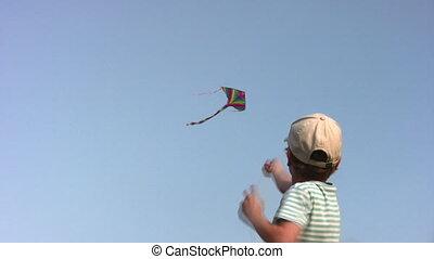 garçon, cerf volant