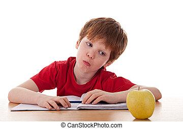 garçon, distrait, pomme, étudier