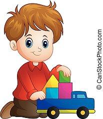 garçon, peu, blocs jouet, maison, camion, construire, dehors